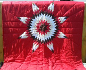 31. Red Blanket with Dark Brown, Red, Yellow and White Star