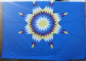 49. Blue Blanket with Yellow, White, Blue and Purple Star.