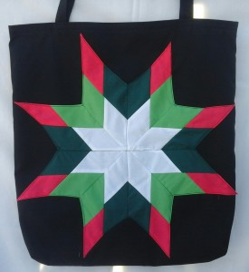 29. Black bag with dark pink, light green and dark green