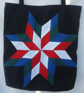 27. Black bag with blue, green, red and white