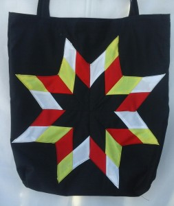 26. Black bag with the four colors.
