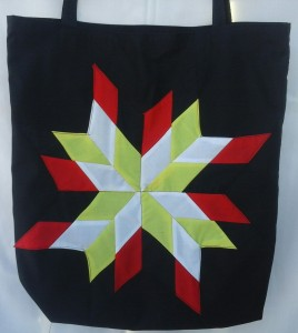 25. Black bag with the four colors