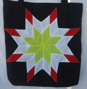 22. Black bag with yellow, white and red star