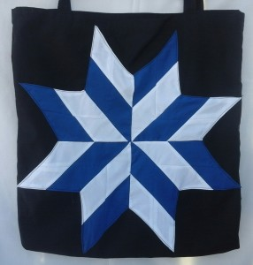 18. Black bag with white and blue star