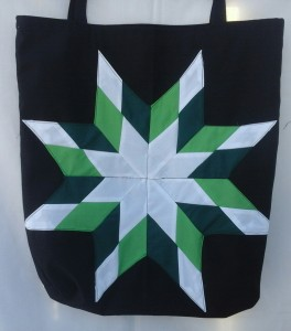 17. Black bag with white, dark & light green star
