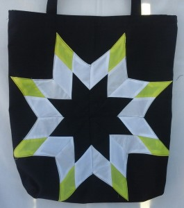 15. Black bag with yellow, white and black star