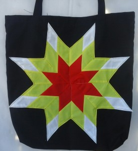 15. Black bag with red, yellow and white star
