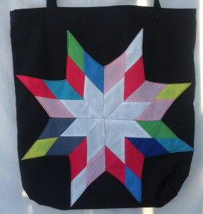 13. Black bag with rainbow star