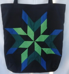 12. Black bag with blue, light & dark green and black star
