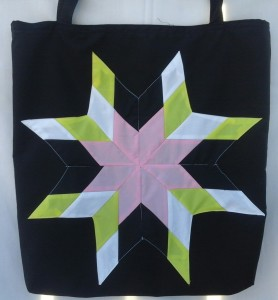 11. black bag with pink, white, yellow and black star