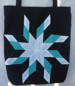 9. black bag with white, turquoise, and black star