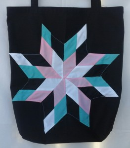 8. black bag with pink, white, turquoise, and black star