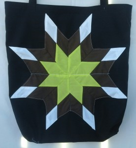 7. black bag with yellow, brown and white star