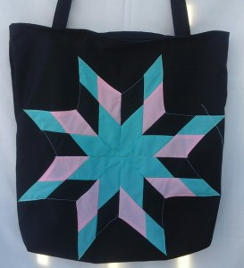 7. Black bag with turquoise, pink and black star