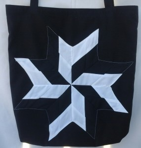 5. Black bag with white and black star