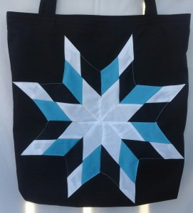 4. Black bag with blue, black, and white star