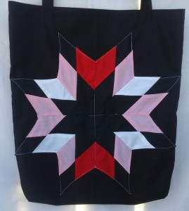 3. Black bag with red, pink, white, and black star
