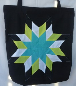 2. black bag with turquoise, yellow, white and black star