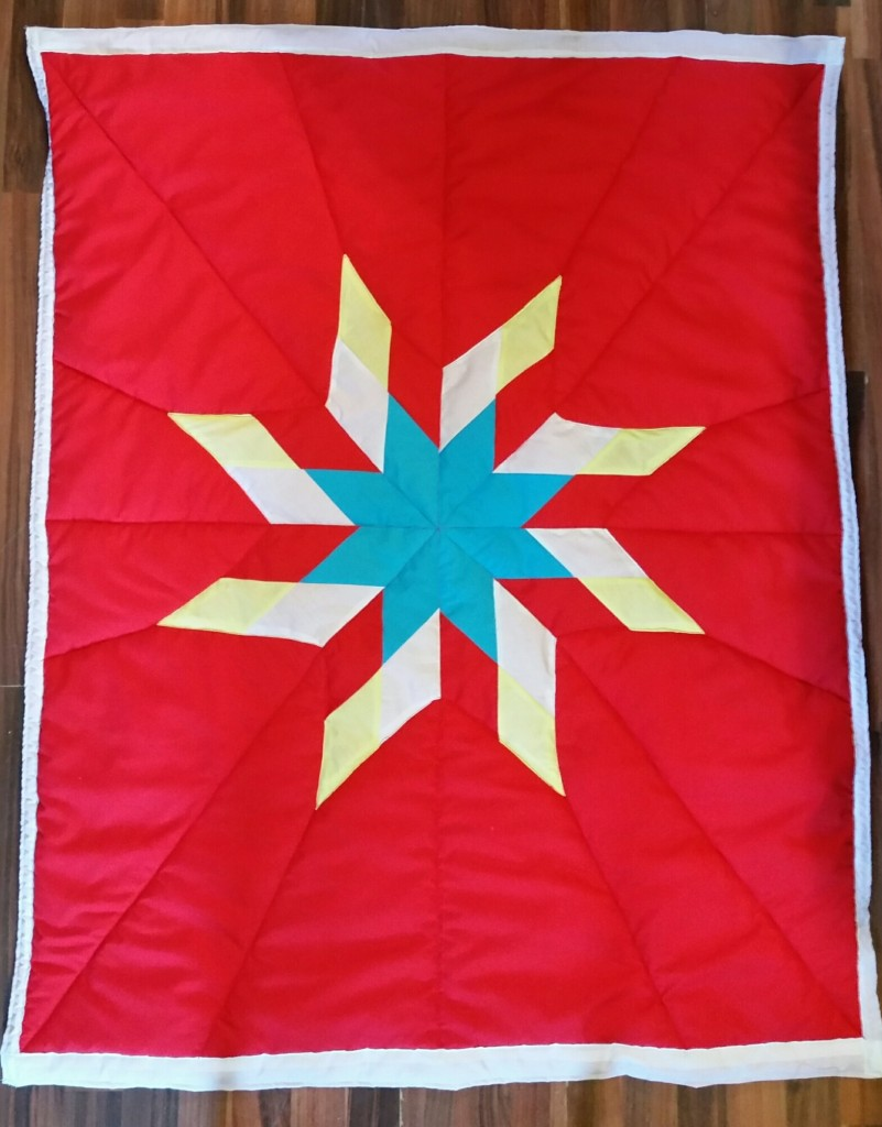 Red Star Blanket with yellow, red, turquoise, and white star.