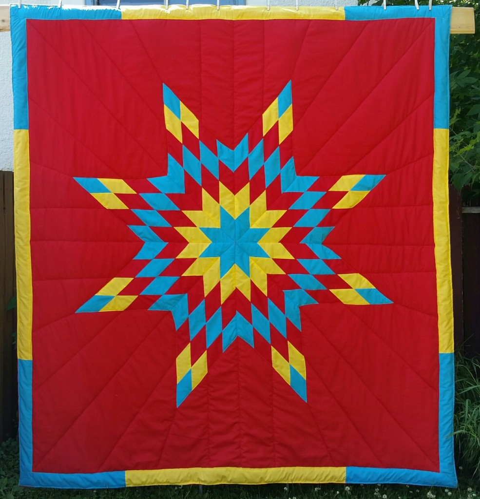 Red Star Blanket with Turquoise, Yellow, and Red Star and Border.