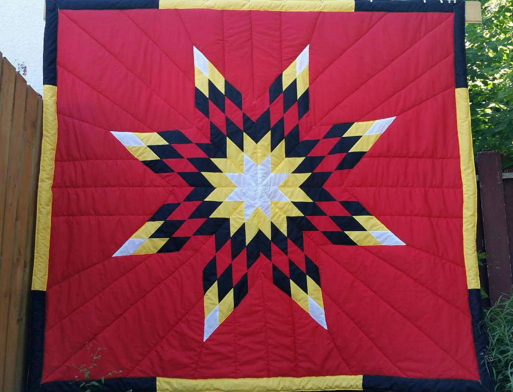 Red Star Blanket with 4 colors in the star and border.