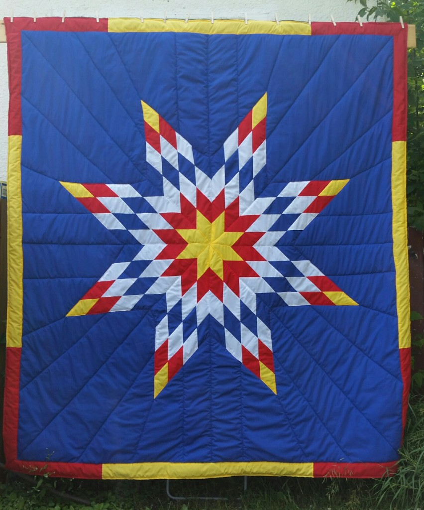Dark Blue Queen Star Blanket with Yellow, Red, White and Dark Blue Star and Border.