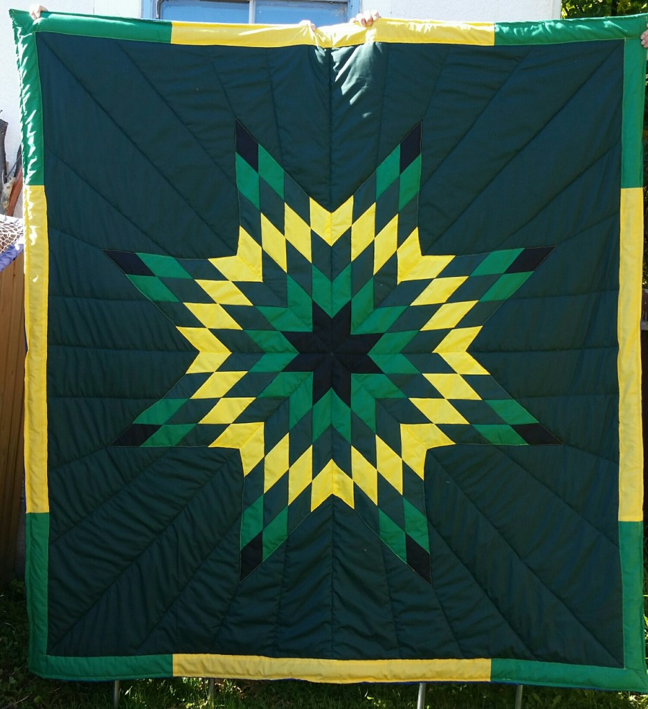 Green Blanket with Black, Light/dark green, and yellow star.