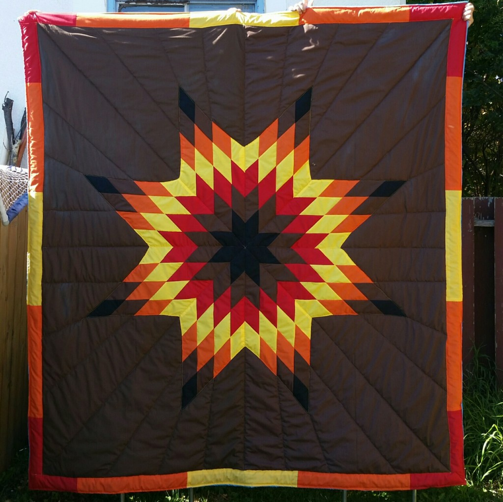 Brown Blanket with Brown, Black, Orange, Red, and Yellow Star.