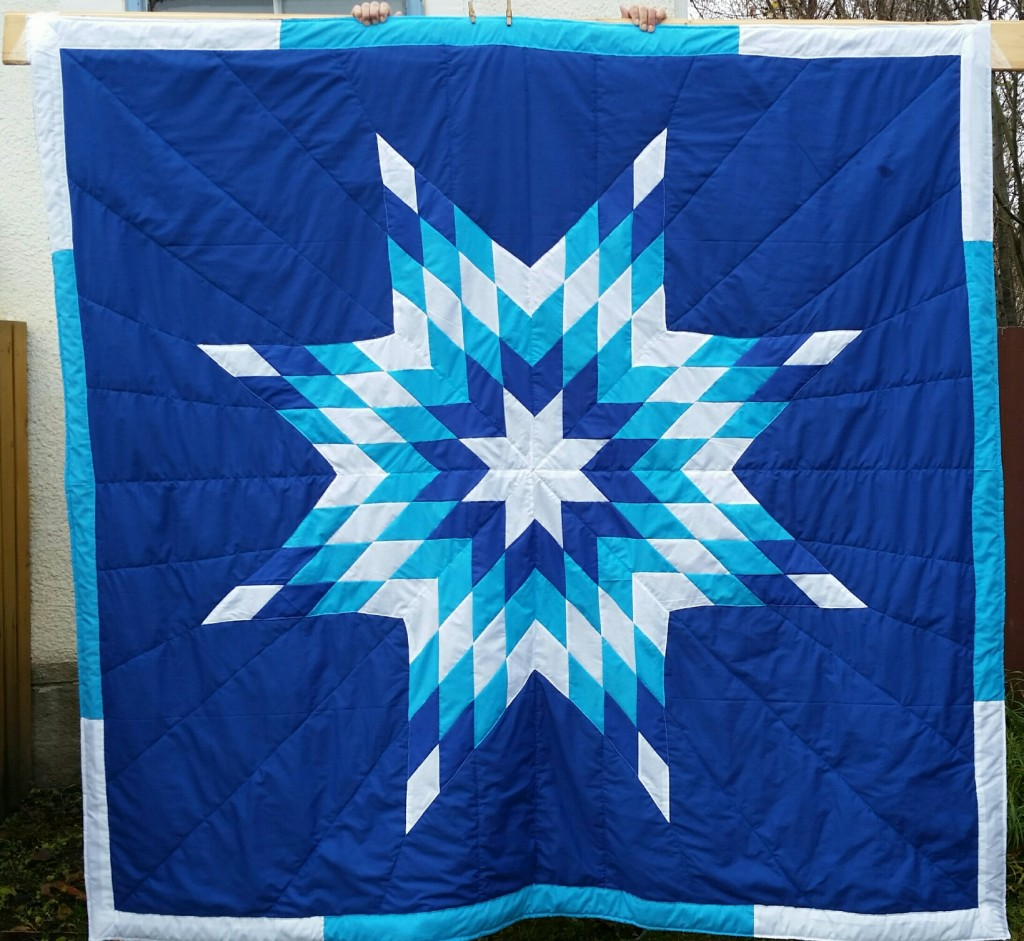 Dark Blue star blanket with white, dark blue and turquoise in the Star.