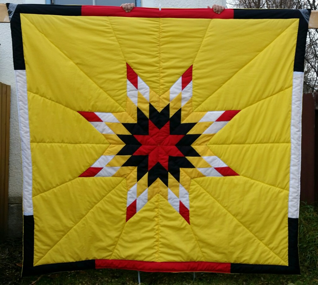 Yellow Star Blanket with 4 colors in the Star