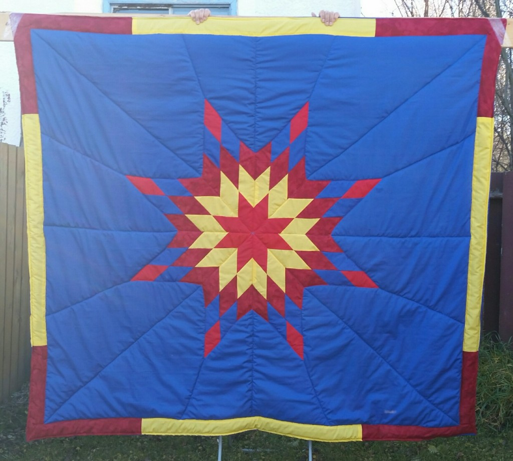 Dark blue blanket with yellow, red, RED PRINT, and dark blue star
