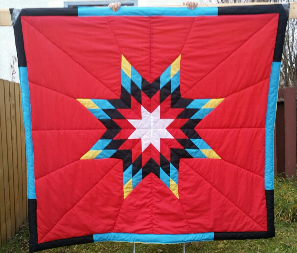 Red Star blanket with white, red, turquoise, black and yellow star