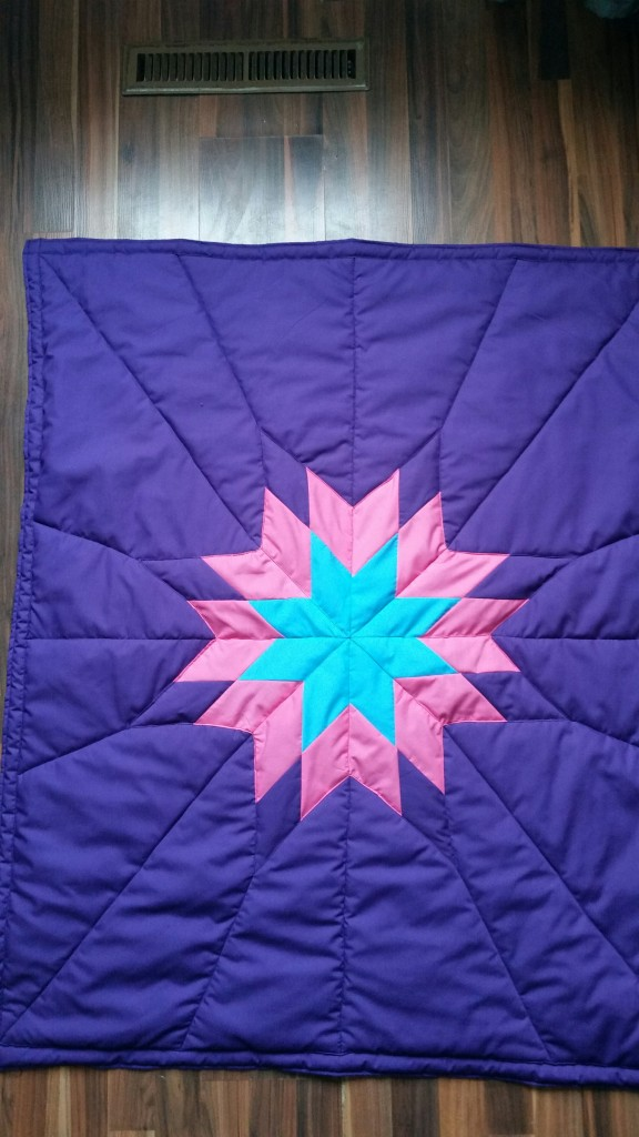 Purple Baby Star Blanket with purple, turquoise and pink star.