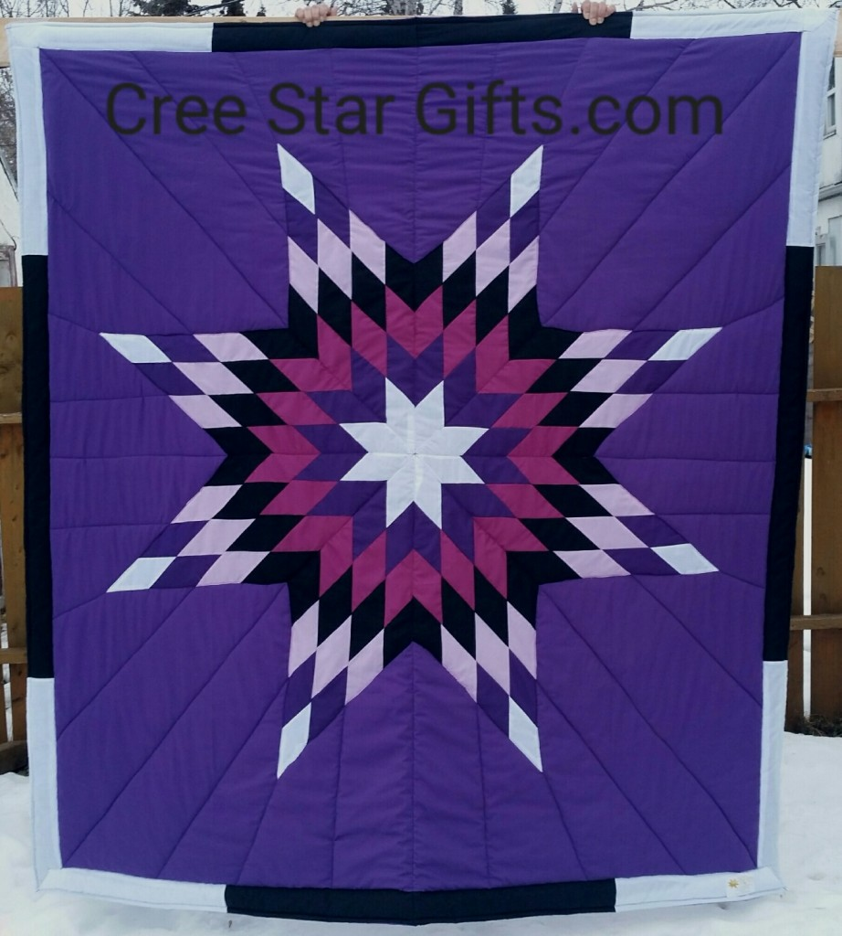 Royal Purple star blanket with white, light/dark purple, black, and eggplant purple star. The border is white and black.