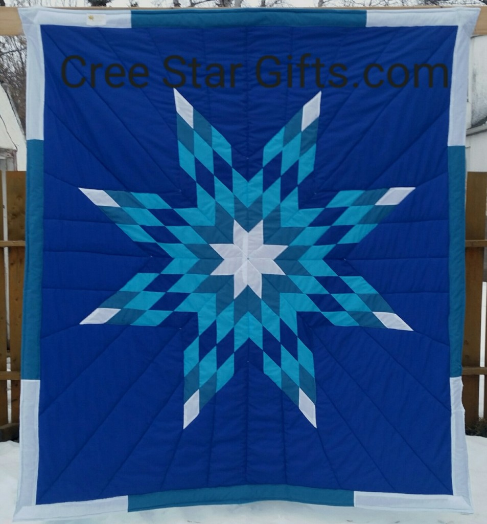 Royal Blue star blanket with white, ocean blue, turquoise and royal blue star. The border white and ocean blue.