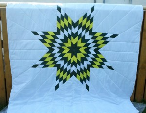33. White Blanket with Green, Yellow and White Star