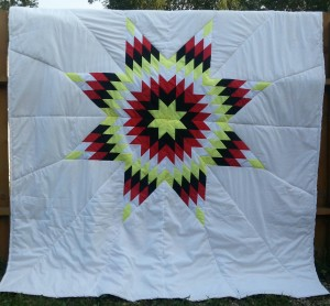 White Star Blanket with yellow, black, red, and white star.