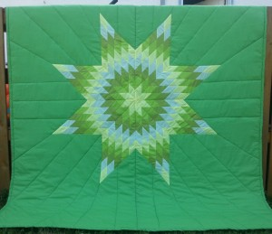 Green Blanket with Yellow, Light & Dark Green, and White Star.