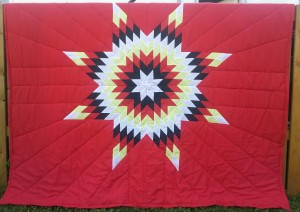Red Blanket with White, Black, Yellow and Red Star.