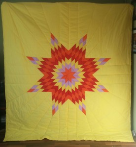 Yellow Star Blanket with orange, light purple, red, and yellow star.