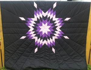 1. Black blanket with White, purple, and black star.