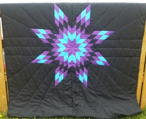 2. Black blanket with purple, turquoise, and black blanket.