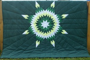45. Green blanket with white, yellow, and green star.