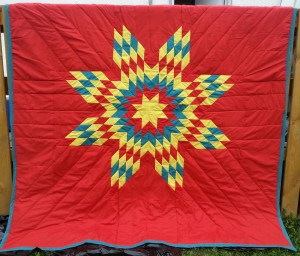 Red Blanket with Yellow, Turquoise, and Red Star