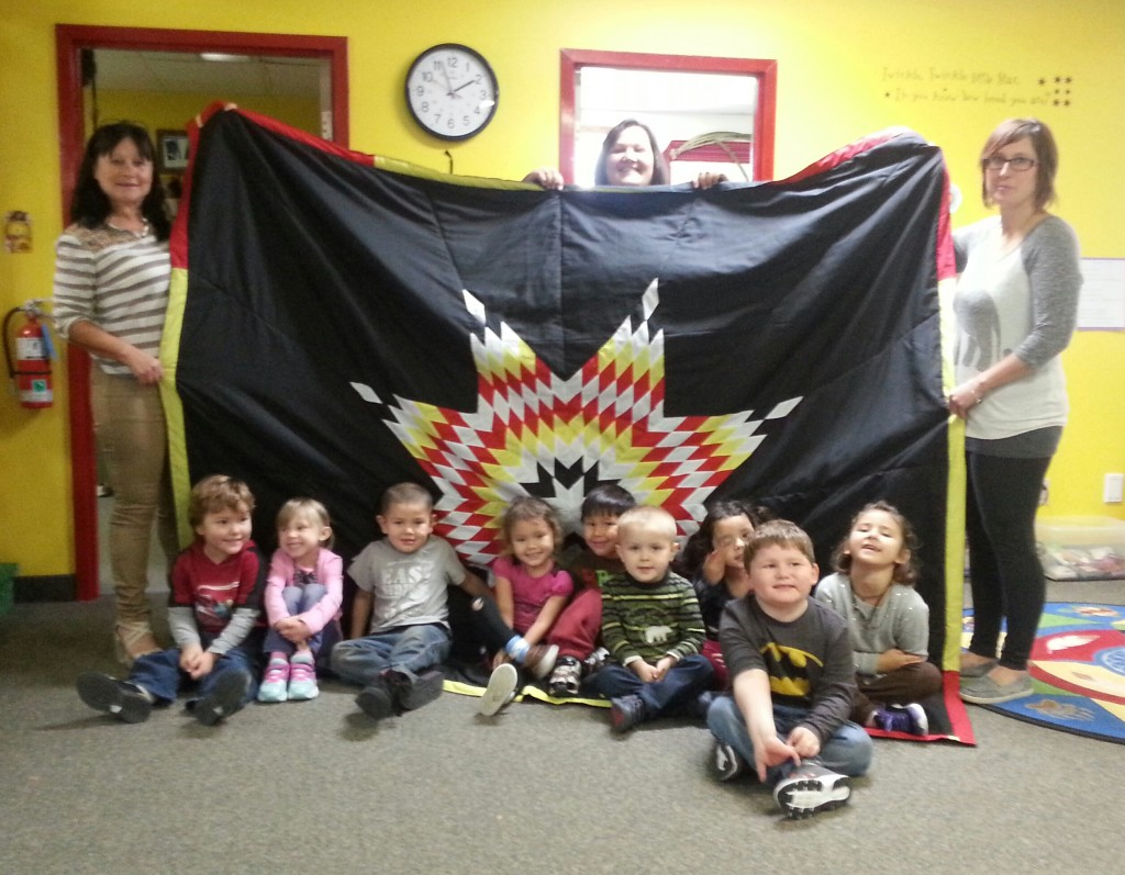 Photo: (left to right) Margaret Church (Coordinator for Headstart Progam), with Staff and Kids.