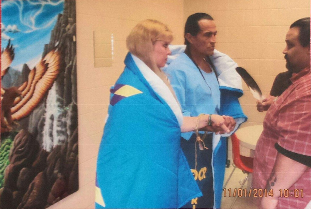 MIcheal & Debbie Hernandez getting married traditionally with Elder and with a Star Blanket wrapped around them purchased from Cree Star Gifts.