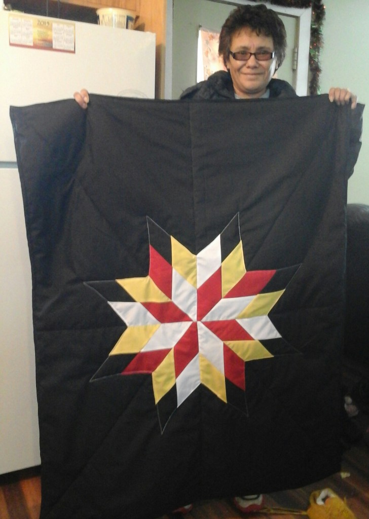 Black Baby Crib Style blanket, with black, red, white and yellow star.