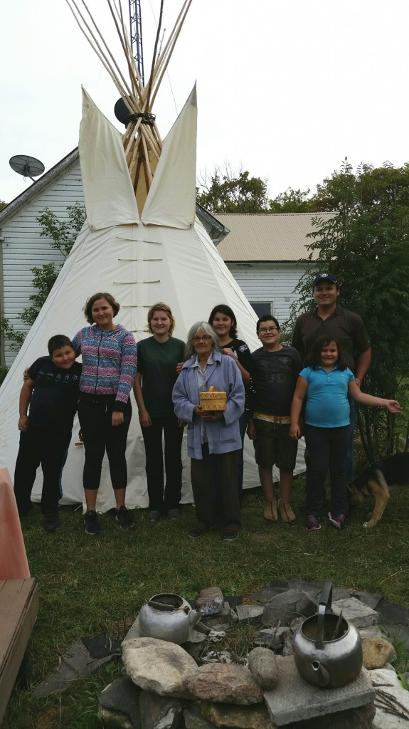 Linda Catcheway (Clan Catcheway), in front of their 14-foot dakota Style Teepee and John + Kids