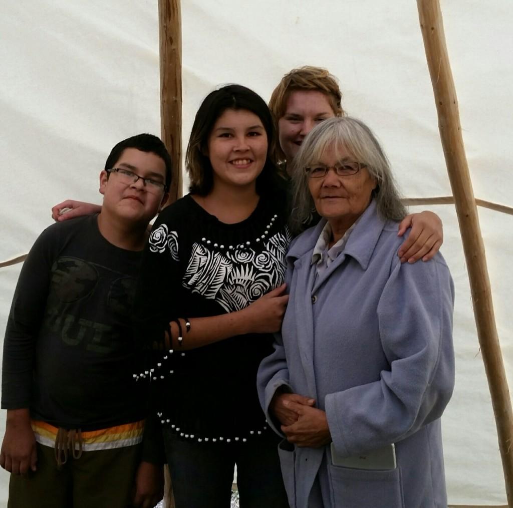 Linda Catcheway with her grandchildren inside the Teepee