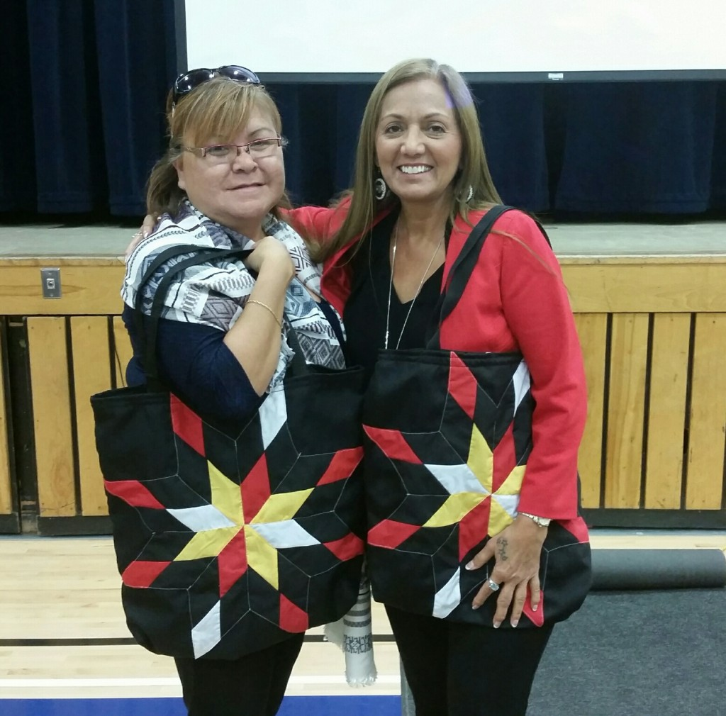 Amanda Simard (left) -TEI Education Manager and Renee McGurry (right) - TEI Facilitator from Treaty Relations Commission of Manitoba are holding Star Bags made by us. They were presenters for our Divisional Professional Development Day today to teach us how to teach kids about the treaties. It was excellent.